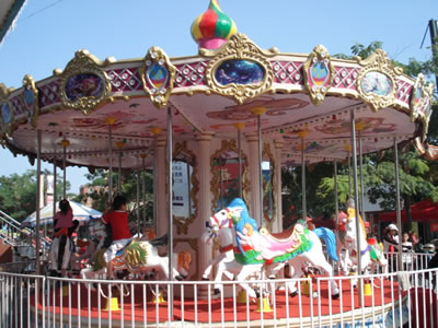 16 persons antique carousel horses